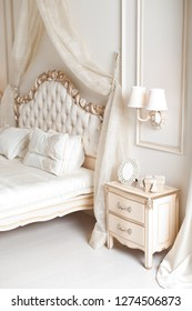 Elegant bedside and sconce or lamp. Luxury interior in white colors