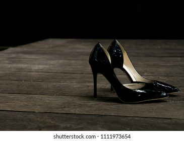 752b95b055ab Elegant black high heel women shoes isolated on wooden floor isolated on  black background
