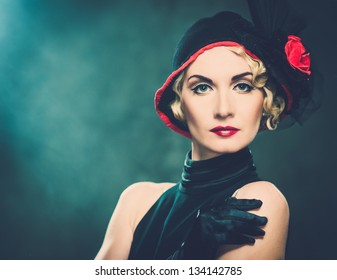 Elegant blond retro woman  wearing little hat with red flower