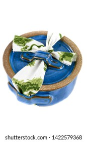 """Elegant blue ceramic pot """"marmita"""" with printed fabric strip, used as packed lunch isolated on white background."""