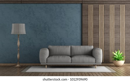 Elegant blue living room with sofa and decorative wooden panel - 3d rendering