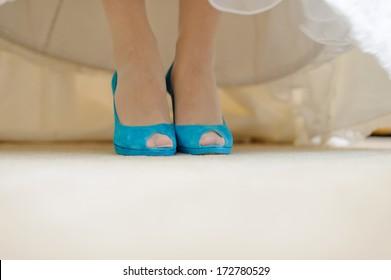 elegant blue shoes on bride's feet