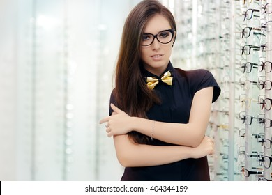 Elegant Bowtie Woman with Cat Eye Frame Glasses in Optical Store - Sophisticated girl wearing eyeglasses in optician shop
