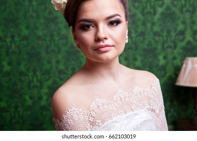 Elegant bride in vintage interior. Professional make up and hairstyle. Bridal fashion model