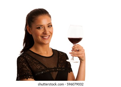 Elegant brunette woman with a glass of red wine