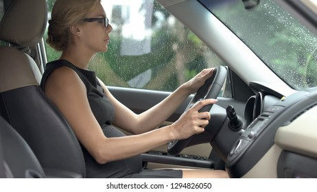 Elegant business lady learning how to drive car, trouble-free pregnancy, health