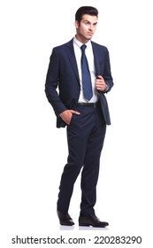 Elegant business man walking on white studio background, with one hand in his pocket and the other one on his jacket, looking away from the camera