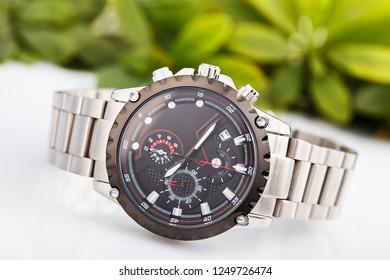 Elegant business men fashion wrist watch with metal bracelet.
