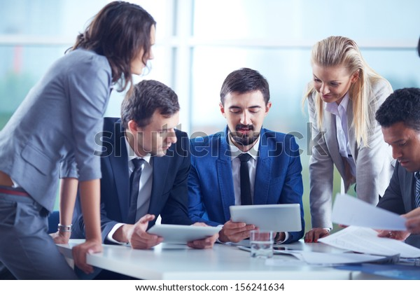 Elegant business partners interacting and planning work at meeting