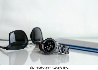 Elegant business unisex fashion no brand wrist watch, smartphone and sunglasses