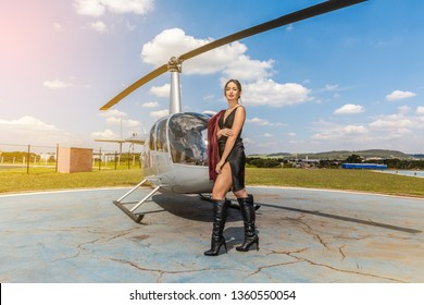 Elegant business woman near the helicopter. Business, success and luxury concept.