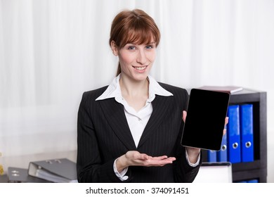 Elegant business woman show the tablet in the office