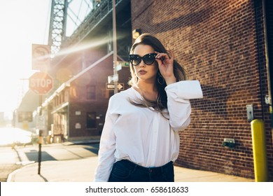 6859c0a19e Elegant business woman wearing sunglasses and white t-shirt at hot summer  day in the