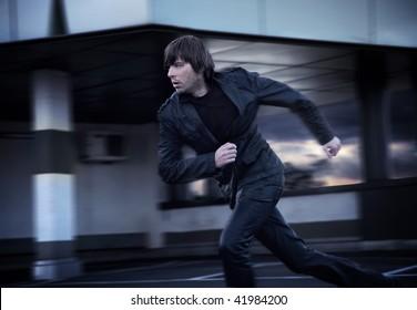 Elegant businessman running