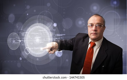 Elegant businessman touching abstract high technology circular buttons