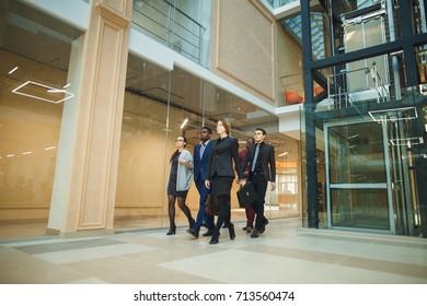 Elegant businesspeople walking in a modern office