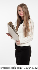 Elegant businesswoman with a resolute look, holding a large file.