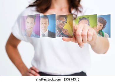 Elegant businesswoman selecting future employees on digital interfaces