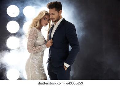 Elegant celeb couple posing on the stage