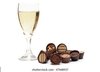 Elegant champagne glass and chocolate on white