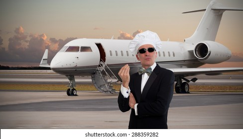 Elegant chef gesturing in front of private jet