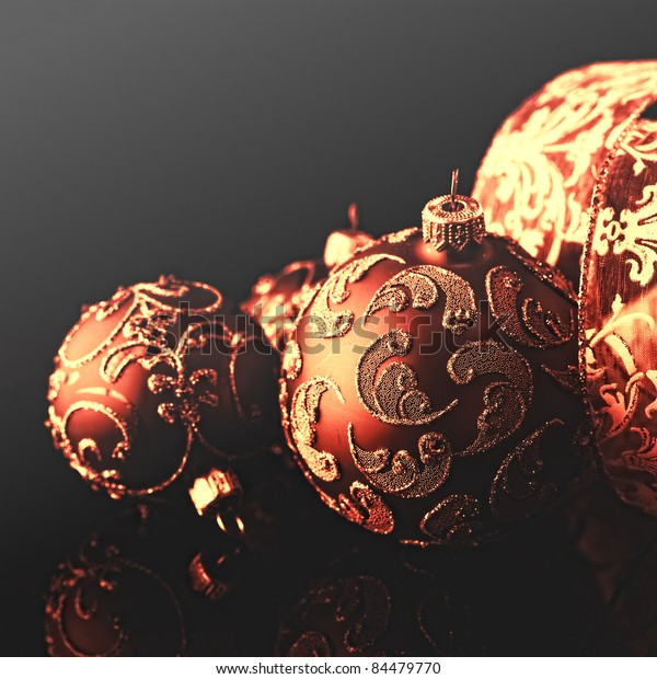 Elegant Christmas Ornaments Against Black Background Stock Photo