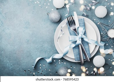 Elegant christmas table setting for holiday dinner top view. Empty space for text. Bokeh effect