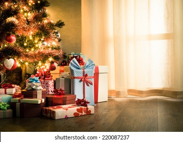 Elegant christmas tree with decorations and gifts on elegant hardwood floor.