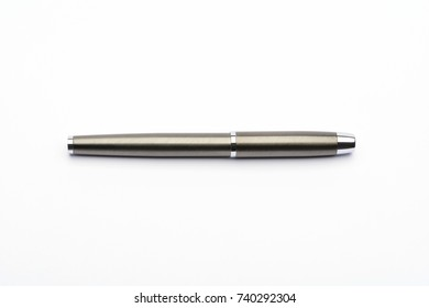 Elegant chrome ballpoint pen isolated on white background