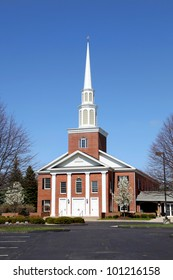 Elegant church building against blue sky