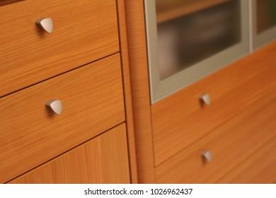 Elegant classic woodenwardrobe drawer front with metal handles