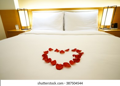 Elegant and comfortable home & hotel bedroom interior as background, the Rose Petals at bed, romantic style.