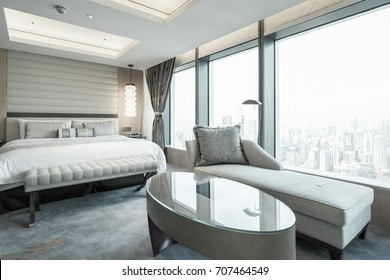 Elegant and comfortable home & hotel bedroom interior. with large floor-to-ceiling Windows overlooking the city.