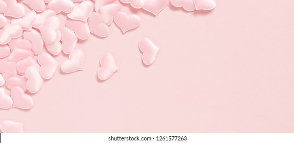 Elegant composition for Valentine's Day. Pink hearts on pastel pink background. Valentine day concept, design. Flat lay, top view, copy space, banner