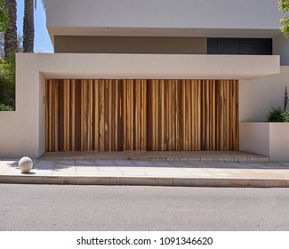 elegant contemporary house entrance with long wooden door, Athens northern wealthy suburbs Greece