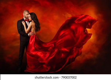Elegant Couple, Dancing Woman in Red Dress Fluttering Flying on wind and Man in Black Suit, Love Beauty Portrait
