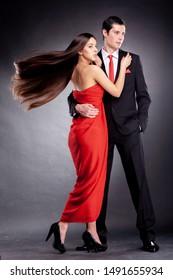 elegant couple in evening dresses
