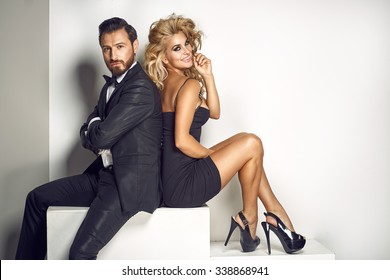Elegant couple looking at the camera