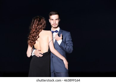 Elegant couple on dark background