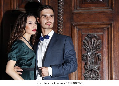 Elegant couple on old wooden door background