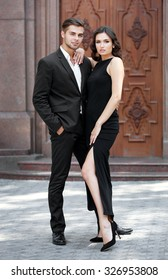 Elegant couple pose outdoors