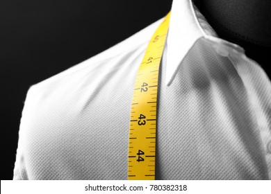 Elegant custom made shirt on mannequin against black background, closeup