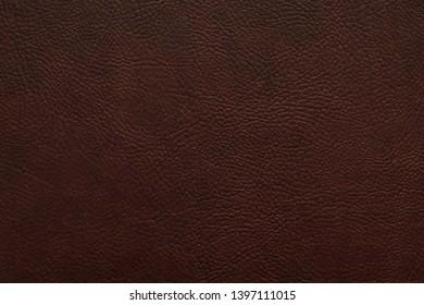 Elegant dark brown leatherette background. Dermantin texture. Copy space.