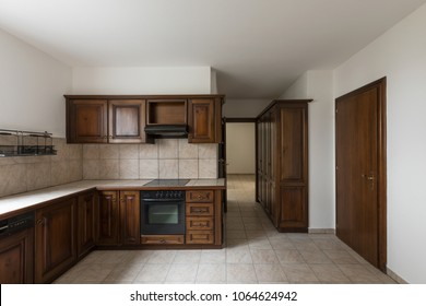 Elegant dark wood kitchen with window. Nobody inside