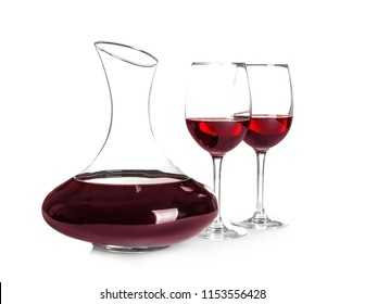 Elegant decanter and glasses with red wine on white background
