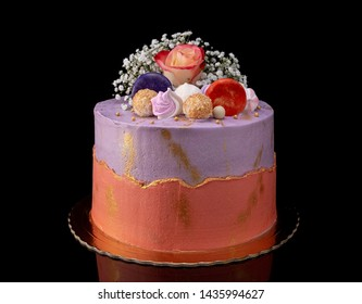 Elegant decorative cake with flowers and marshmallows. On the holidays.