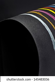 elegant design composition made of simple colorful pastel lines on bent black paper