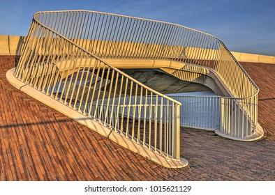 Elegant detail with white fencing and red bricks on the recently completed bridge De Lentloper in Nijmegen, The Netherlands