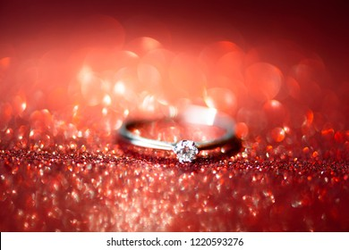 Elegant diamond ring. Glitter background