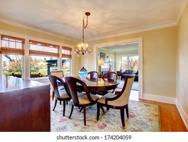 Elegant dining room with brown wood dining table set and iron chandelier